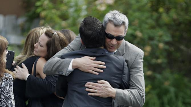 "Mourners embrace outside of Robert Spearing Funeral Home for a private viewing for actor James Gandolfini, Wednesday, June 26, 2013, in Park Ridge, N.J. Gandolfini, who played Tony Soprano in the HBO show ""The Sopranos"", died while vacationing in Italy last week. (AP Photo/Julio Cortez)"