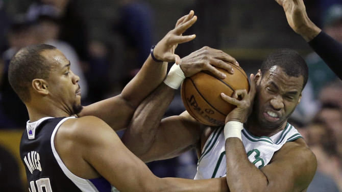 """FILE - In this Jan. 30, 2013, file photo, Boston Celtics center Jason Collins, right, struggles for control of the ball with Sacramento Kings forward Chuck Hayes (42) during the second half of an NBA basketball game in Boston. ESPN says that it regrets the """"distraction"""" caused by one of its reporters who described Jason Collins as a sinner after the NBA center publicly revealed that he was gay. Chris Broussard, who covers the NBA for ESPN, had said on the air that Collins and others in the NBA who engage in premarital sex or adultery were """"walking in open rebellion to God, and to Jesus Christ.""""  (AP Photo/Elise Amendola, File)"""