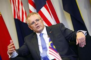 Australia's Minister of Immigration and Border Protection Scott Morrison speaks at a news conference during his working visit to Malaysia, in Putrajaya