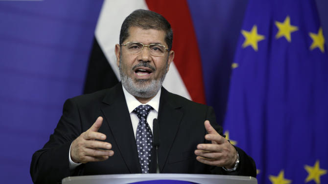 Egyptian President Mohamed Morsi gestures while speaking during a media conference at EU headquarters in Brussels on Thursday, Sept. 13, 2012. This is Egyptian President Mohammed Morsi's first trip to the European Union since being elected president. (AP Photo/Virginia Mayo)