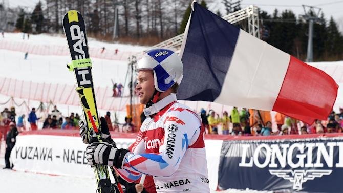 FIS Ski World Cup men's giant slalom winner Alexis Pinturault of France walks towards the podium in Naeba, Japan's Niigata prefecture, on February 13, 2016