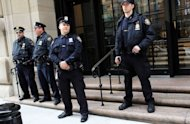 <p>Police stand in front of the Federal Reserve Bank in New York City. A Bangladeshi man with alleged al-Qaeda links was arrested on Wednesday in New York on charges of trying to use a 1,000 pound bomb to destroy the city's Federal Reserve building.</p>
