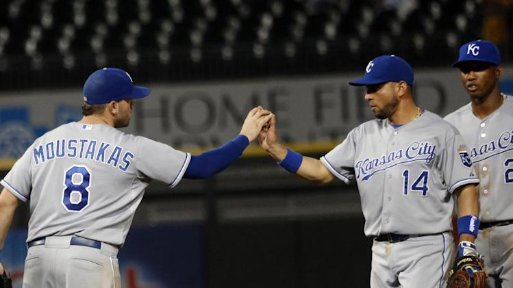 Kansas City Royals third baseman Mike Moustakas (8) celebrates with second baseman Omar Infante, the Royals' 7-1 win over the Chicago White Sox after a baseball game Tuesday, July 22, 2014, in Chicago. (AP Photo/Stacy Thacker)