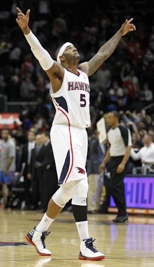 File-This March 3, 2012 file photo shows Atlanta Hawks forward Josh Smith celebrating after defeating the Oklahoma City Thunder in an NBA basketball game in Atlanta. A person familiar with the deal tells The Associated Press that the Detroit Pistons have agreed to a $54 million, four-year contract with free agent Josh Smith. The person spoke Saturday July 6, 2013 on the condition of anonymity because the agreement has not been announced. NBA rules prevent confirmation of moves until July 10, when Smith is expected to sign his deal. (AP Photo/John Bazemore, File) (AP Photo/John Bazemore)