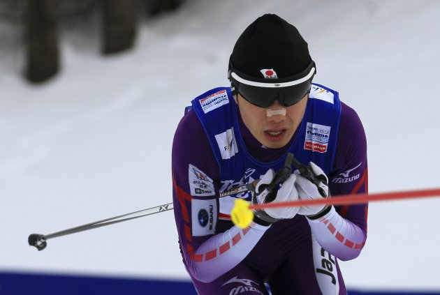 Taihei Kato of Japan skis to finish sixth in the men's nordic combined individual Gundersen 10km competition at the Nordic World Ski Championships in Val di Fiemme