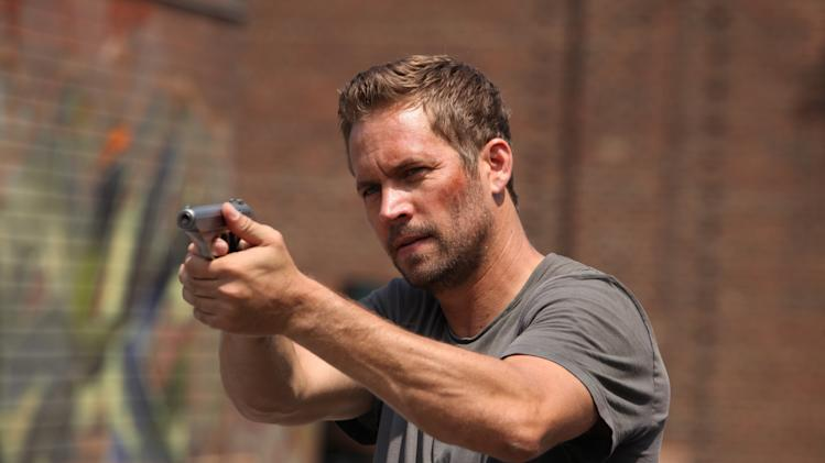 "This image released by Relativity Media shows Paul Walker in a scene from ""Brick Mansions."" (AP Photo/Relativity Media, Philippe Bosse)"