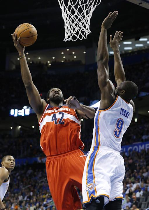 Washington Wizards forward Nene (42) shoots in front of Oklahoma City Thunder forward Serge Ibaka (9) in the first quarter of an NBA basketball game in Oklahoma City, Sunday, Nov. 10, 2013
