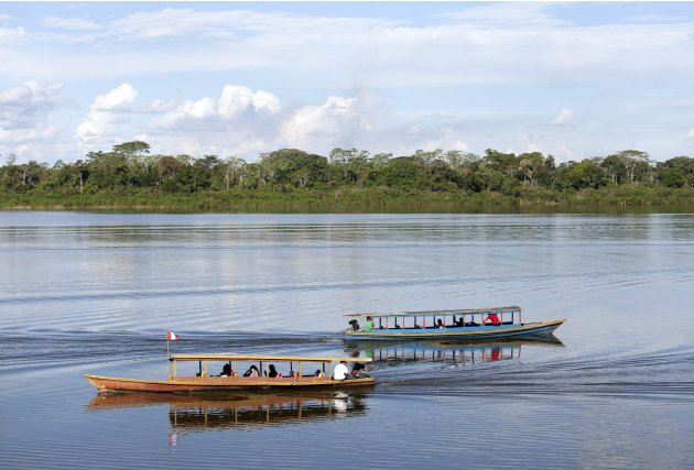 Motorboats cruise through the Yarinaqucha lagoon, near Peru's Amazon city of Pucallpa