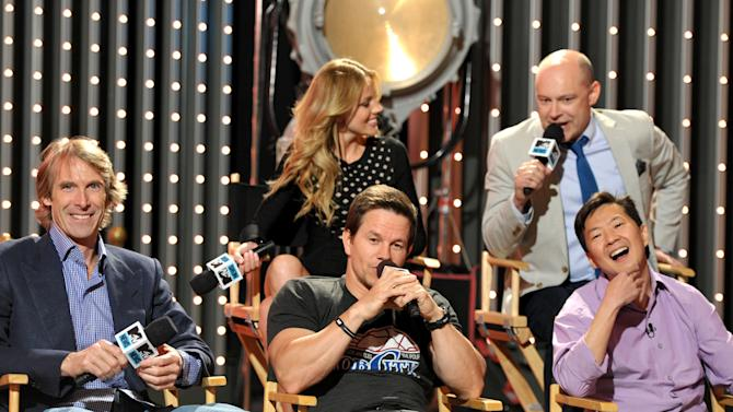 "Members from the cast and crew of  ""Pain & Gain"" from left, director Michael Bay actors Mark Wahlberg, Ken Jeong, background right, Rob Corddry, and Bar Pal  are seen at ""The MTV Movie Awards Sneak Peek Week"" on Tuesday, April 9, 2013 in Universal City, Calif. (Photo by John Shearer/Invision for MTV/AP Images)"