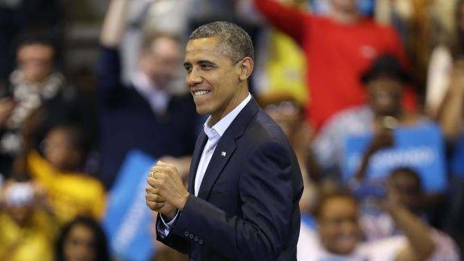 President Barack Obama starts to move to the music of performer Stevie Wonder who was off-stage performing at the end of the campaign event at Fifth Third Arena, Sunday, Nov. 4, 2012, in Cincinnati. (AP Photo/Pablo Martinez Monsivais)