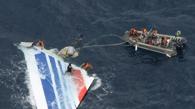 FILE - In this Monday, June 8, 2009 file photo released by Brazil's Air Force, Brazil's Navy sailors recover debris from the missing Air France Flight 447 in the Atlantic Ocean. French investigators are releasing much-awaited details Friday July 29, 2011 about what happened in the final minutes before an Air France jet crashed in the Atlantic Ocean in 2009. The French air accident investigation agency BEA is issuing a report Friday into the crash based on readings from the so-called black box flight recorders. (AP Photo/Brazil's Air Force, file)  ** NO SALES  **