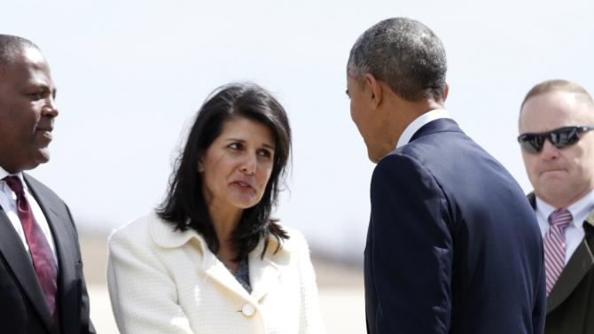 South Carolina Governor Haley extends her hand to Obama upon Obama's arrival in Columbia