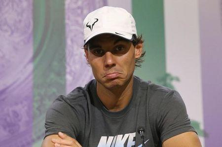 Rafael Nadal of Spain attends a news conference after being defeated by Nick Kyrgios of Australia in their men's singles tennis match at the Wimbledon Tennis Championships, in London