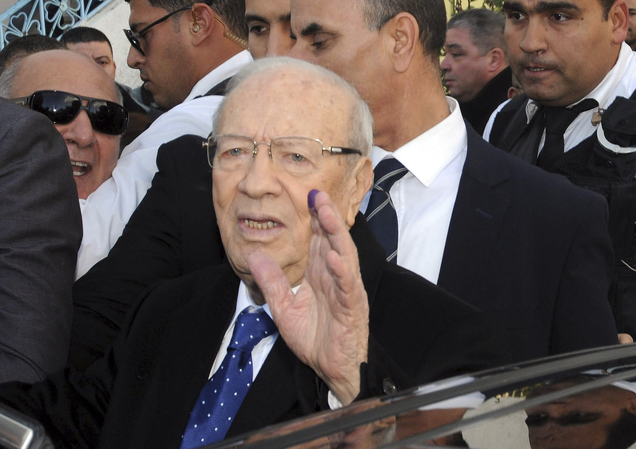 Exit poll: Ex-regime official is Tunisia's new president