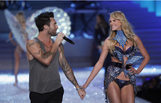 Levine, lead singer of Maroon 5, walks down the runway with model Vyalitsyna during the Victoria's Secret Fashion Show in New York