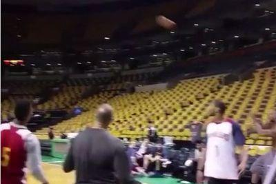 LeBron throws basketball like a baseball, scores from full court