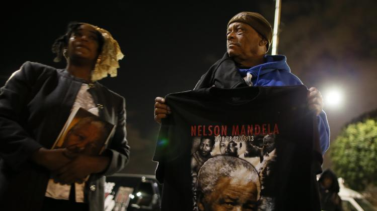 People participate in a candlelight vigil in memoriam of Nelson Mandela's death, in Los Angeles