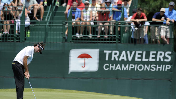 Bubba Watson watches his putt on the eighth green during the second round of the Travelers Championship golf tournament in Cromwell, Conn., Friday, June 21, 2013. Watson shot a 3-under par 67 in his round, to go 10-under par for the tournament. (AP Photo/Fred Beckham)