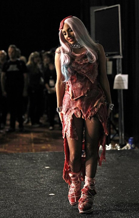 "FILE - In this Sept. 12, 2010 file photo, singer Lady Gaga walks backstage wearing a dress made of meat after accepting the award for video of the year for ""Bad Romance"" at the MTV Video Music Awards"