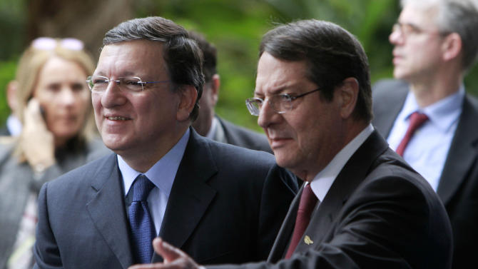 Cyprus' main opposition Democratic Rally party leader Nicos Anastasiades, right, welcomes the EU Commission President Jose Manuel Barosso as he arrives for a European People's Party (EEP) meeting in Cyprus' southern coastal resort of Limassol in an extraordinary summit on Friday, Jan. 11, 2013. Among the topics of discussion at the meeting hosted by the leader of Cyprus' main opposition Democratic Rally party Nicos Anastasiades will be the EU budget. Anastasiades is currently leading opinion polls as the top contender ahead of the country's Feb. 17 presidential election. Cyprus is in the midst of talks with international lenders on a bailout to rescue its ailing banking sector that sustained massive losses on bad Greek debt and loans. (AP Photo/Petros Karadjias)