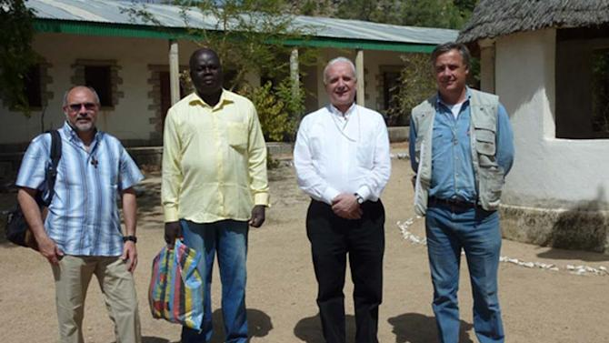 This photo released by Vicenza Diocesi, Saturday April 5, 2014 shows Vicenza Bishop Beniamino Pizziol, second from right, flanked by father Gianantonio Alllegri, left, and Giampaolo Marta, right, during a visit in Jericho, near Maroua, Cameroon, on Jan. 2014. Officials say two Italian priests and a Canadian nun working as missionaries in northern Cameroon have been abducted. Italy's foreign ministry said the abduction occurred during the night between Friday and Saturday about 30 kilometers (20 miles) from the border with Nigeria. It identified the priests as Giampaolo Marta and Gianantonio Allegri, but declined to give other details, including the Canadian's identity, to avoid compromising efforts for the missionaries' release.( AP Photo/Vicenza Diocese)