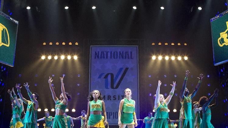 "This theater image released by The Hartman Group shows Adrienne Warren, center left, and Taylor Louderman, center right, during a performance of ""Bring It On: The Musical,"" at the St. James Theatre in New York. (AP Photo/The Hartman Group, Joan Marcus)"