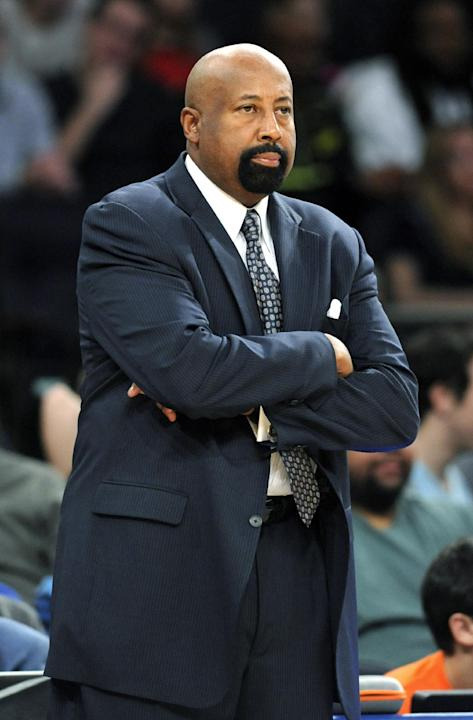 New York Knicks coach Mike Woodson watches during the fourth quarter of an NBA basketball game against the Memphis Grizzlies on Saturday, Dec. 21, 2013, at Madison Square Garden in New York. The Grizz