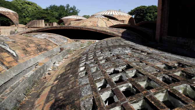 The domed roof of an old ballet school stands abandoned in Havana, Cuba, Friday, Nov. 2, 2012.  Carlos Acosta, a 39-year-old celebrity ballet star from Cuba, pledges to raise millions of dollars to rescue the ruins of the architectural masterpiece that was abandoned in mid-construction five decades ago and turn it into an international center for culture and dance. (AP Photo/Franklin Reyes)