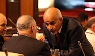 Libya&#39;s ruling national assembly picked Mohamed al-Megaryef (R) as its president. Megaryef, born in 1940 in the eastern city of Benghazi, was elected to the GNC under the flag of his grouping, renamed the National Front Party. The poll for leadership of the new congress was broadcast live on Libyan television