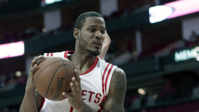 Houston Rockets' Trevor Ariza (1) grabs a rebound in front of Detroit Pistons' Greg Monroe in the first half of an NBA basketball game Friday, March 6, 2015, in Houston. (AP Photo/Pat Sullivan)