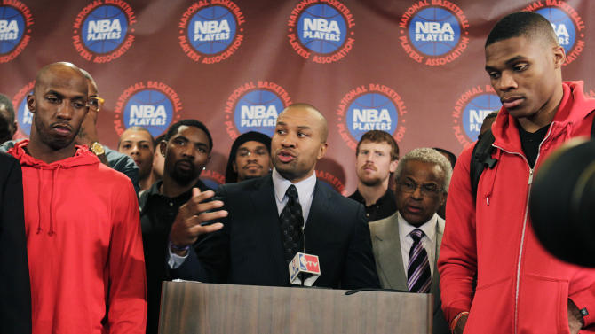 Surrounded by NBA players, including New York Knicks' Chauncy Billups, left, and Oklahoma City Thunder's Russell Westbrook, right, NBA Players Association president Derek Fisher speaks during a news conference after a meeting of the players' union in New York, Monday, Nov. 14, 2011. The NBA players rejected the league's latest offer and have begun the process to disband the union. (AP Photo/Seth Wenig)