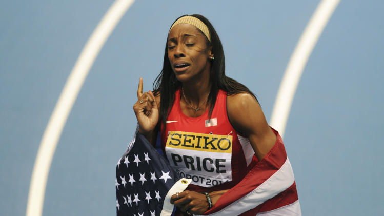 United States' Chanelle Price celebrates winning the gold medal in the women's 800m final during the Athletics Indoor World Championships in Sopot, Poland, Sunday, March 9, 2014. (AP Photo/Alik Keplicz)