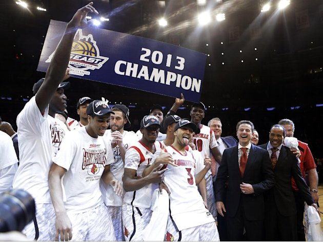 FILE - In this March 16, 2013, file photo, Louisville's Peyton Siva (3) celebrates with teammates after an NCAA college basketball championship game against Syracuse at the Big East Conference tournam