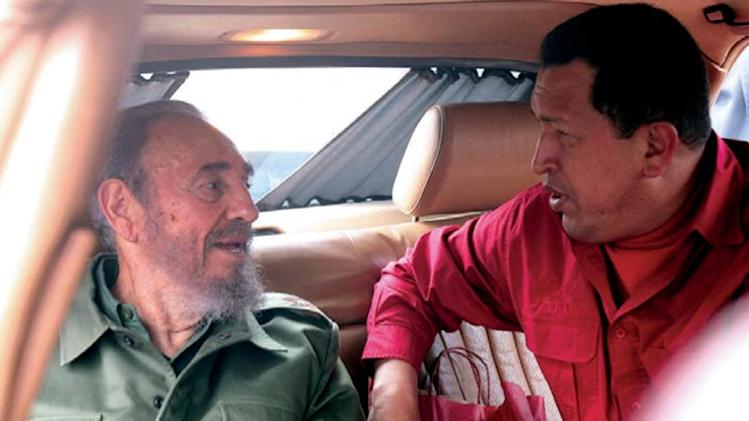 "FILE - In this July 22, 2006 file photo released by Miraflores Press Office, Venezuela's President Hugo Chavez , right, speak with Cuba's Fidel Castro during their visit to the home of Cuban revolutionary Ernesto ""Che"" Guevara in Cordoba, Argentina. (AP Photo/Miraflores Press Office, File)"