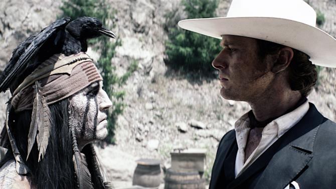 "This film publicity image released by Disney shows Johnny Depp as Tonto, left, and Armie Hammer as The Lone Ranger, in a scene from ""The Lone Ranger."" (AP Photo/Disney Enterprises, Inc.)"