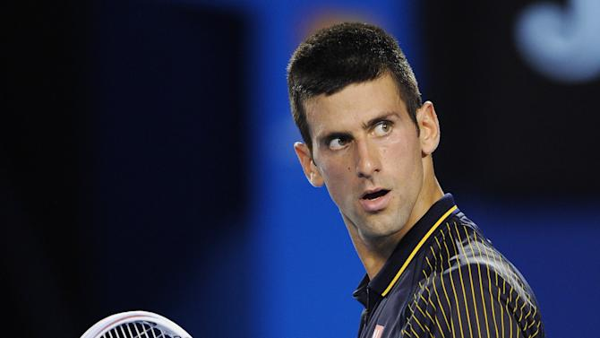 Serbia's Novak Djokovic reacts after winning the second set against Spain's David Ferrer during their semifinal match at the Australian Open tennis championship in Melbourne, Australia, Thursday, Jan. 24, 2013. (AP Photo/Andrew Brownbill)