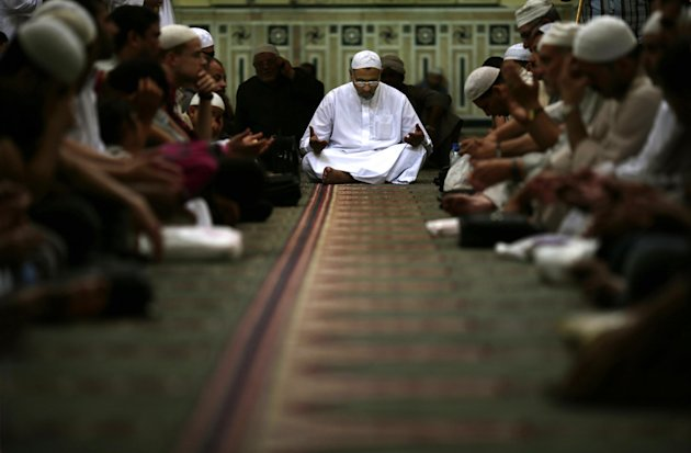 In this Tuesday, June 4, 2013 photo, Egyptian Sufi Muslims perform Hadra as they celebrate Moulid inside the Sayyeda Zeinab shrine in Cairo, Egypt. The hadra is an Islamic act where attendees perform dhikr, a ritual of supplication that often includes recitation of God's 99 names in Islam. Depending on the particular Sufi order, it can contain elements such as singing, dancing and music. Egypt's roughly 15 million Sufi Muslims say their places of worship are under threat by rising radicalism. They say that since the country's 2011 uprising that toppled longtime autocrat Hosni Mubarak, shrines held sacred to them have been attacked by hardliners who deem them heretical and idolatrous. (AP Photo/Hassan Ammar)