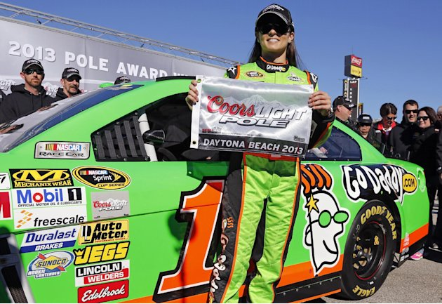 Danica Patrick displays the flag after winning the pole during qualifying for the NASCAR Daytona 500 Sprint Cup Series auto race at Daytona International Speedway, Sunday, Feb. 17, 2013, in Daytona Be