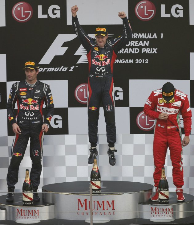 Red Bull Formula One driver Vettel celebrates winning the South Korean F1 Grand Prix next to team mate Webber and Ferrari's Alonso at the Korea International Circuit in Yeongam
