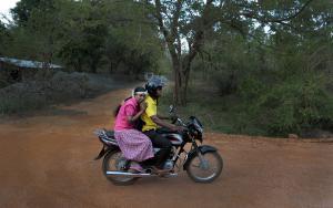 In this July 24, 2014, photo, V.G. Karunawathie, left,…