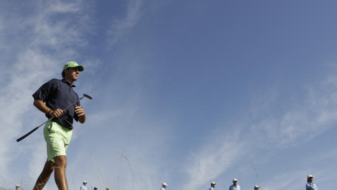 Kelly Kraft of Denton, Texas, makes his way to the sixth hole during the semifinals at the U.S. Amateur golf tournament Saturday, Aug. 27, 2011, at Erin Hills Golf Course in Erin, Wis. (AP Photo/Morry Gash)