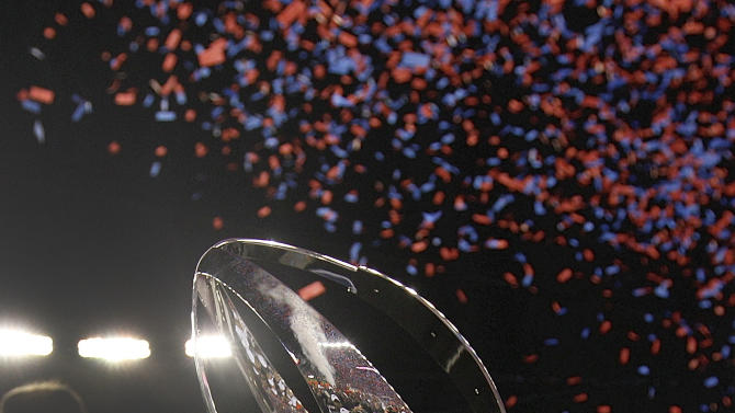 Members of the New England Patriots hold up the championship trophy after the AFC Championship NFL football game Sunday, Jan. 22, 2012, in Foxborough, Mass. The Patriots defeated the Ravens 23-20 to win the AFC Championship. (AP Photo/Charles Krupa)