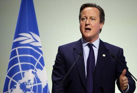 Britain's Prime Minister Cameron delivers a speech during the opening session of the World Climate Change Conference 2015 (COP21) at Le Bourget