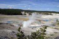 FILE- This September 2009 file photo shows the Norris Geyser Basin in Yellowstone National Park, Wyo. Planning a vacation with three generations _ grandparents, parents and kids _ can be tricky. A road trip to U.S. National Parks is one option. (AP Photo/Beth Harpaz, FILE)