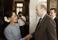 "French Foreign Minister Alain Juppe is greeted by Myanmar opposition leader Aung San Suu Kyi at her home in Yangon. After the historic meeting Juppe said the European Union will respond ""in concrete terms"" to recent reforms by Myanmar's regime"