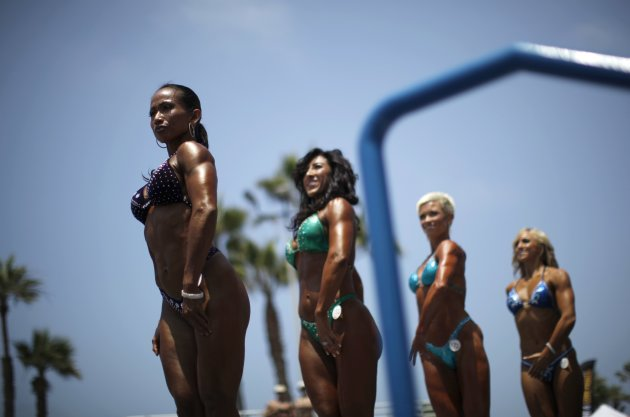 Women compete in the Muscle Beach Independence Day bodybuilding contest on Venice Beach in Los Angeles, California