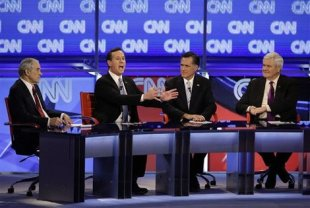 The four Republican presidential hopefuls debate the issues Wednesday night in Arizona. (AP Photo/Jae C. Hong)