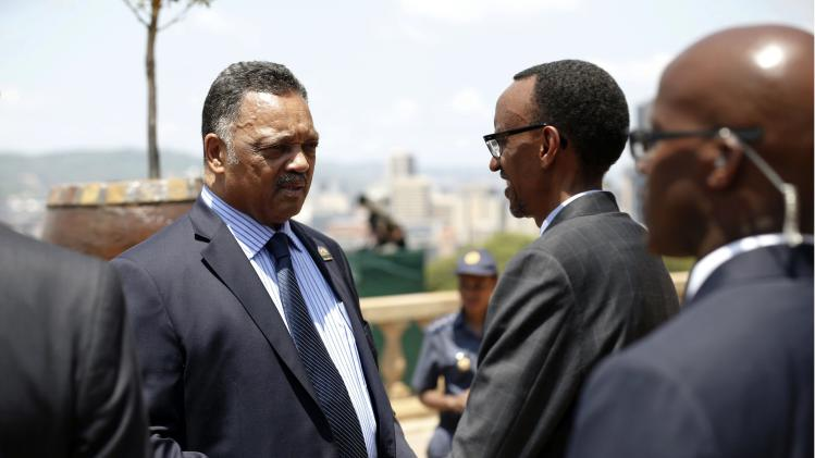 U.S. civil rights leader Jackson speaks with Rwanda's President Kagame after paying their respects to former South African President Mandela in Pretoria