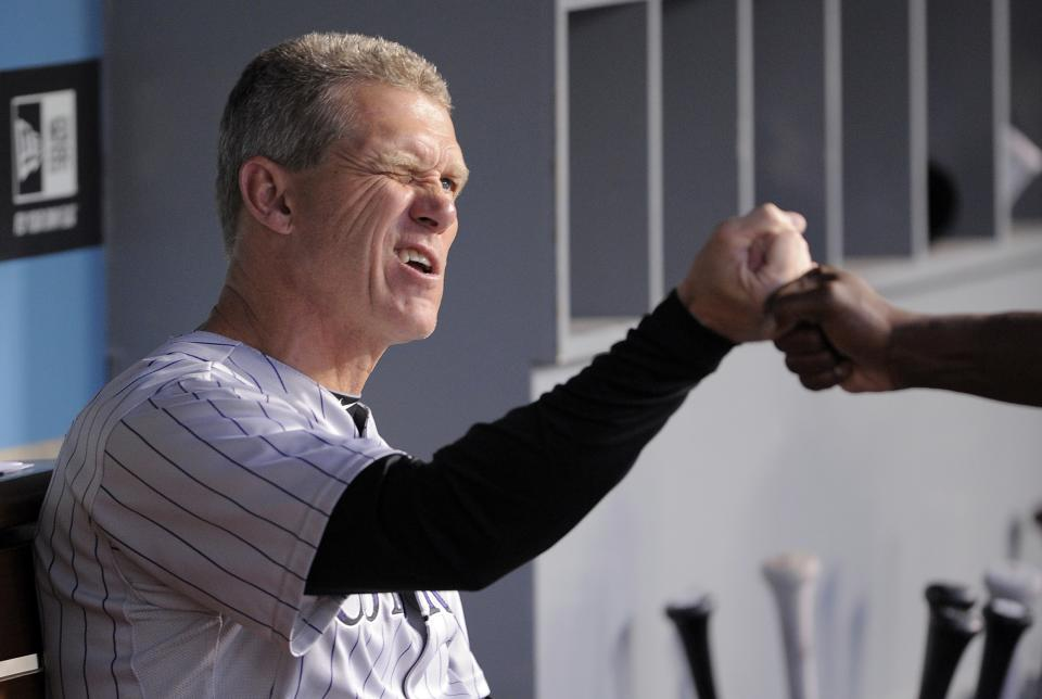 Colorado Rockies manager Jim Tracy, left, fist pumps first base coach Glenallen Hill before their baseball game against the Los Angeles Dodgers, Friday, Aug. 26, 2011, in Los Angeles. (AP Photo/Mark J. Terrill)