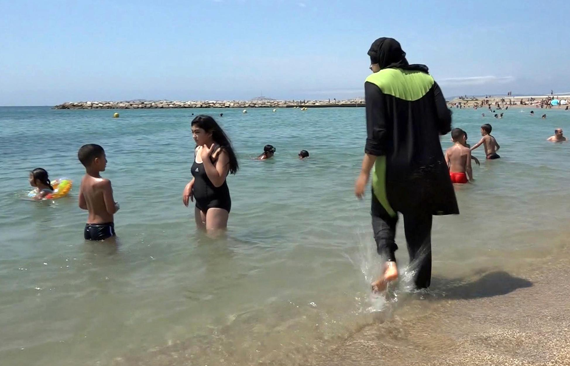 French lawyers seek overturn on burkini bans; verdict Friday